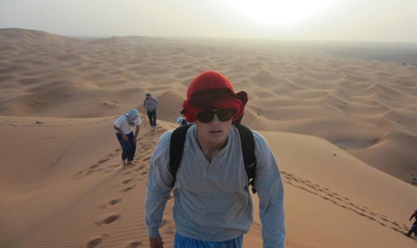 Walking the dunes in Morocco.